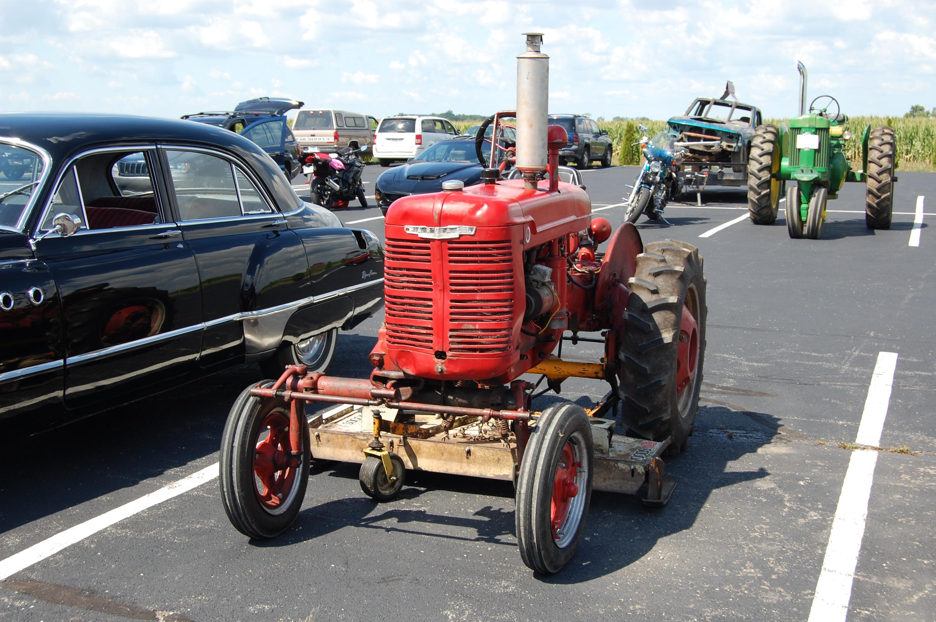 Mini Antique Tractors : Mini antique car tractor show an ever changing sky